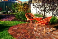Circular paving in lawn spaces