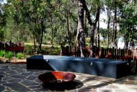 Contemporary screens behind seating with firepit